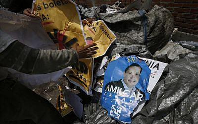 Workers collect electoral propaganda at a garbage dump in Mexico City, June 29, 2018. (AP Photo / Marco Ugarte)