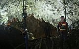 Thai police guard the entrance to a cave complex where 12 boys and their soccer coach went missing, in Mae Sai, Chiang Rai province, in northern Thailand, July 1, 2018. (AP Photo/Sakchai Lalit)