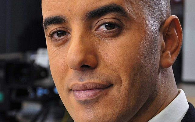 Notorious French criminal Redoine Faid poses prior to an interview with French all-news TV channel, LCI, as he was promoting his book, in Boulogne-Billancourt, outside Paris, France, November 22, 2010. (IBO/Sipa via AP)