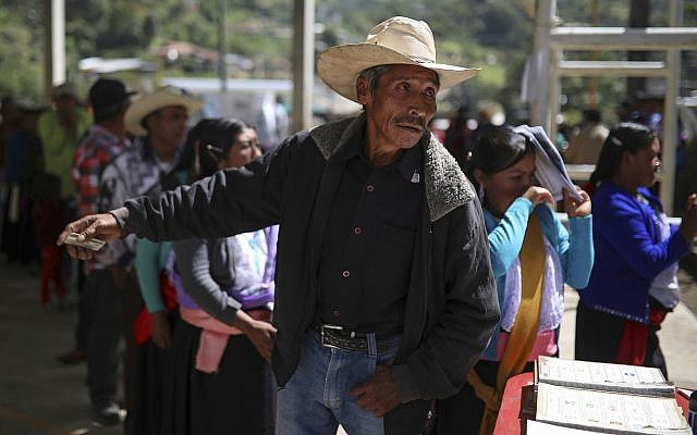 A man asks a question at a polling station during general elections in the indigenous community of Soledad Atzompa, Veracruz state, Mexico, July 1, 2018. (AP Photo/Felix Marquez)