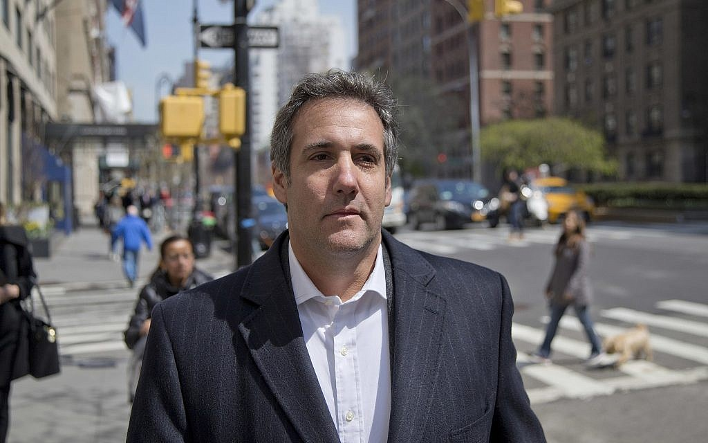 In this file photo from April 11, 2018, attorney Michael Cohen walks down the sidewalk in New York. (AP Photo/Seth Wenig, File)
