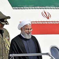 Iranian President Hassan Rouhani, right, arrives at the Zurich airport, in Kloten, Switzerland, July 2, 2018. (KEYSTONE/Walter Bieri via AP)