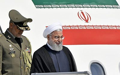Iranian President Hassan Rouhani, right, arrives at the Zurich airport, in Kloten, Switzerland, July 2, 2018. (KEYSTONE/Walter Bieri via AP)