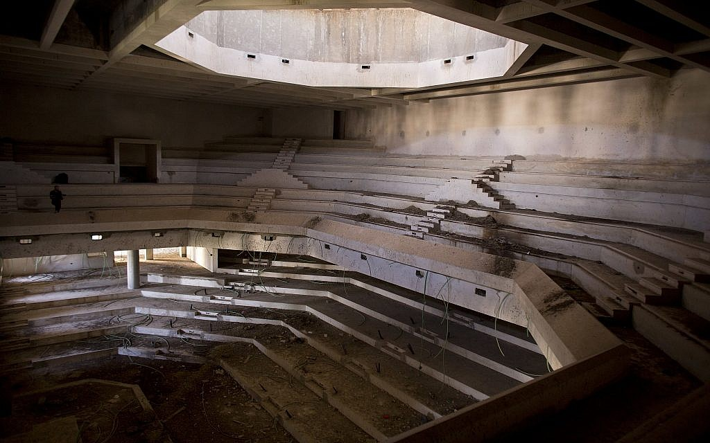 This Monday, June 25, 2018 file photo shows a view of the plenum hall of what was to be a Palestinian parliament in Abu Dis in the West Bank. (AP Photo/Dusan Vranic, File)