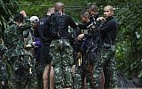 Rescuers prepare dive gear at the entrance to a cave complex in which 12 boys and their soccer coach are trapped in Mae Sai, Chiang Rai province, in northern Thailand, July 4, 2018.  (AP Photo/Sakchai Lalit)