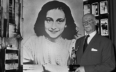 In this Monday, June 14, 1971 photo Dr. Otto Frank holds the Golden Pan award, given for the sale of one million copies of the famous paperback 'The Diary of Anne Frank' in London, Great Britain. (AP/Dave Caulkin)