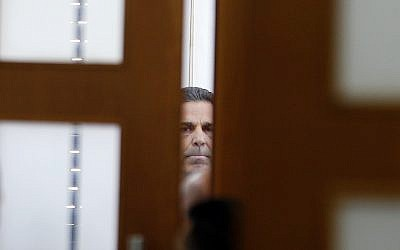 Gonen Segev, a former Israeli government minister indicted on suspicion of spying for Iran, is seen in the District Court in Jerusalem, Thursday, July 5, 2018. (Ronen Zvulun/Pool Photo via AP)