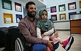 In this Thursday, July 5, 2018 photo, Syrian refugee Maya Meri, 8, sits on her father Mohammed's lap after being fitted with prosthetic legs at a rehabilitation clinic in Istanbul. (AP Photo/Lefteris Pitarakis)
