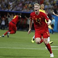 Belgium's Kevin De Bruyne, center, celebrates after scoring his side's second goal during the quarterfinal match between Brazil and Belgium at the 2018 soccer World Cup in the Kazan Arena, in Kazan, Russia, on July 6, 2018. (AP Photo/Frank Augstein)