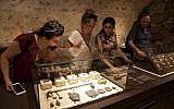 "n this Wednesday, June 27, 2018 photo, visitors look at exhibits, entitled ""The House of Herod: Life and Power in the Age of the New Testament,"" at the Terra Sancta Museum in Jerusalem. Jerusalem's Franciscan friars have opened The Terra Sancta Museum, a new museum in the old city of Jerusalem, filled with artefacts from biblical sites relating to daily life in Jesus' time. (AP Photo/Caron Creighton)"