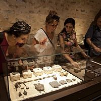 "n this Wednesday, June 27, 2018 photo, visitors look at exhibits, entitled ""The House of Herod: Life and Power in the Age of the New Testament,"" at the Terra Sancta Museum in Jerusalem. (AP Photo/Caron Creighton)"