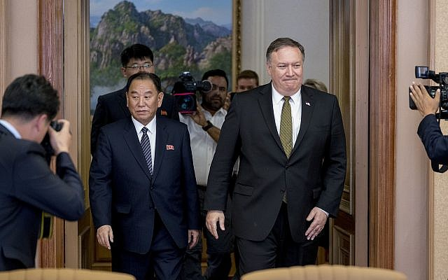 US Secretary of State Mike Pompeo, right, and Kim Yong Chol, left, a North Korean senior ruling party official and former intelligence chief, return to discussions after a break at Park Hwa Guest House in Pyongyang, North Korea, July 7, 2018. (AP Photo/Andrew Harnik, Pool)