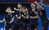 Croatia national soccer team players celebrate after a penalty is saved in a shootout during the quarterfinal match between Russia and Croatia at the 2018 soccer World Cup in the Fisht Stadium, in Sochi, Russia, Saturday, July 7, 2018 (AP Photo/Manu Fernandez)