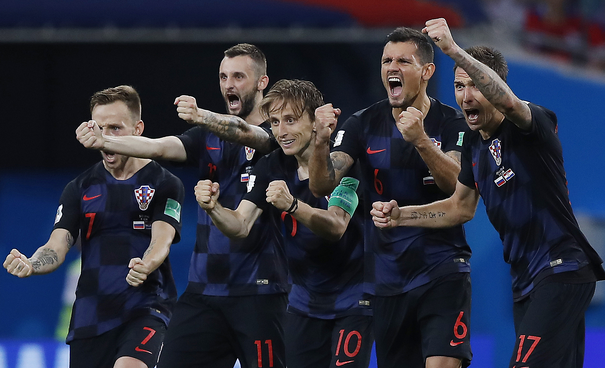 Croatia national soccer team players celebrate after a penalty is saved in a shootout during the quarterfinal match between Russia and Croatia at the 2018 soccer World Cup in the Fisht Stadium in Sochi Russia Saturday