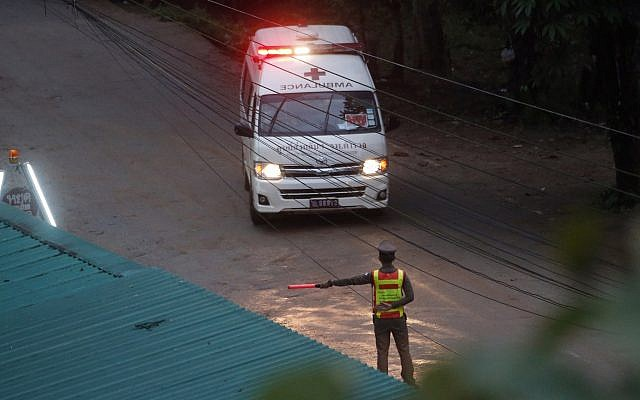 One of two ambulances leaves a cave in northern Thailand hours after an operation begins to rescue trapped youth soccer players and their coach, in Mae Sai, Chiang Rai province, in northern Thailand, July 8, 2018 (AP Photo/Sakchai Lalit)