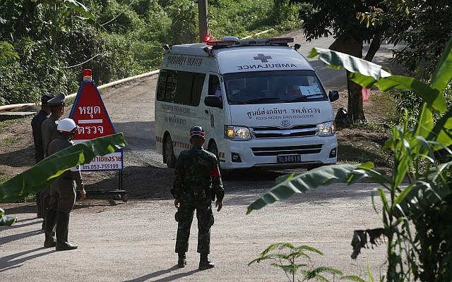 An ambulance with flashing lights leaves the cave rescue area in Mae Sai, Chiang Rai province, northern Thailand, on July 9, 2018. (AP Photo/Sakchai Lalit)