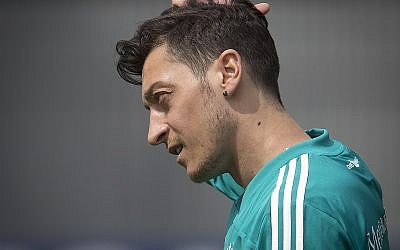 In this June 14, 2018, photo Mesut Ozil scratches his head during a training session of the German team at the 2018 soccer World Cup in Vatutinki near Moscow, Russia. (AP Photo/Michael Probst)