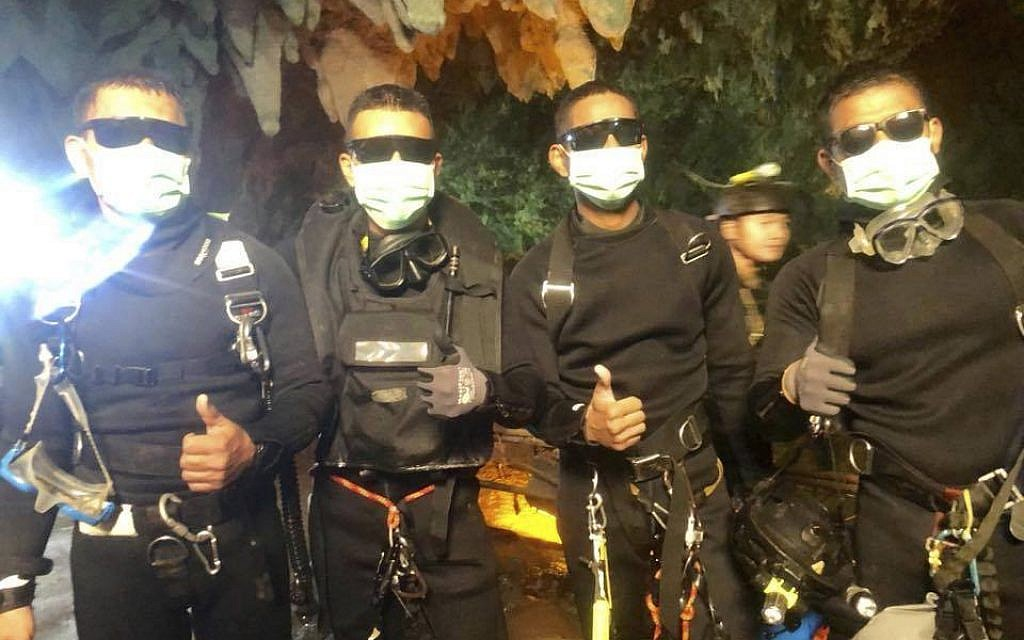 In this undated photo released by Royal Thai Navy on Tuesday, July 10, 2018 show the last four Thai Navy SEALs come out safely after completing the rescued mission inside a cave where 12 boys and their soccer coach have been trapped since June 23, in Mae Sai, Chiang Rai province, northern Thailand. (Royal Thai Navy via AP)