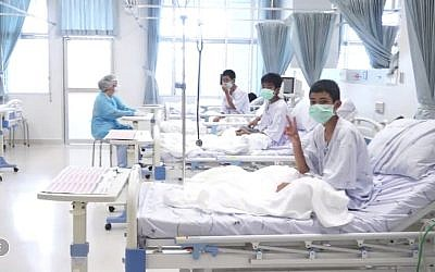 In this image made from video, released by the Thailand Government Spokesman Bureau, three of the 12 boys are seen recovering in their hospital beds after being rescued along with their coach from a flooded cave in Mae Sai, Chiang Rai province, northern Thailand, July 11, 2018. (Thailand Government Spokesman Bureau via AP)