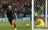 Croatia's Ivan Perisic celebrates after scoring his side's first goal during the semifinal match between Croatia and England at the 2018 soccer World Cup in the Luzhniki Stadium in Moscow, Russia, Wednesday, July 11, 2018. (AP Photo/Alastair Grant)