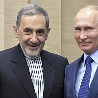 Russian President Vladimir Putin, right, with Ali Akbar Velayati, a senior adviser to Iran's Supreme Leader Ayatollah Ali Khamenei, at Novo-Ograyovo, Moscow, Russia, July 12, 2018. (Alexei Druzhinin, Sputnik, Kremlin Pool Photo via AP)