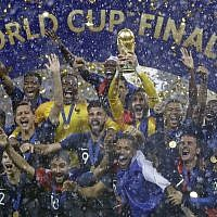 France goalkeeper Hugo Lloris holds the trophy aloft after the final match between France and Croatia at the 2018 soccer World Cup in the Luzhniki Stadium in Moscow, Russia, Sunday, July 15, 2018. (AP/Matthias Schrader)