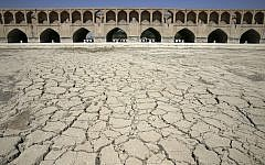 In this Tuesday, July 10, 2018 photo, the Zayandeh Roud river no longer runs under the 400-year-old Si-o-seh Pol bridge, named for its 33 arches, in Isfahan, Iran. (AP Photo/Vahid Salemi)