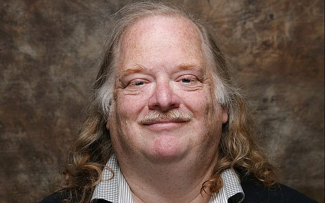 In this photo from January 26, 2015, Jonathan Gold, poses at the LA Times photo and video studio at the Sundance Film Festival, in Park City, Utah. (Jay L. Clendenin /Los Angeles Times via AP)
