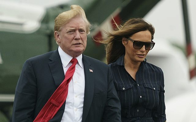 US President Donald Trump and first lady Melania Trump walk from Marine One to board Air Force One at Morristown Municipal Airport, in Morristown, New Jersey, Sunday, July 22, 2018, en route to Washington after staying at the Trump National Golf Club in Bedminster, New Jersey. (AP Photo/Carolyn Kaster)