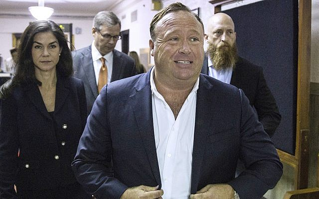 In this file photo from April 17, 2017, 'Infowars' host Alex Jones arrives at the Travis County Courthouse in Austin, Texas. (Tamir Kalifa/Austin American-Statesman via AP, File)