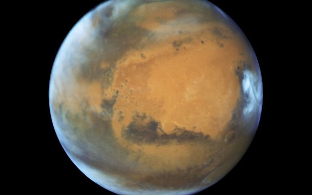 This May 12, 2016, image shows the planet Mars. (NASA/ESA/Hubble Heritage Team - STScI/AURA, J. Bell - ASU, M. Wolff - Space Science Institute via AP)