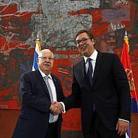 President Reuven Rivlin, left, shakes hands with his Serbian counterpart Aleksandar Vucic at the Serbia Palace in Belgrade, Serbia, July 26, 2018. (Darko Vojinovic/AP)