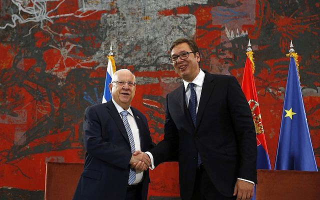 President Reuven Rivlin, left, shakes hands with his Serbian counterpart Aleksandar Vucic at the Serbia Palace in Belgrade, Serbia, July 26, 2018. (Darko Vojinovic/AP)