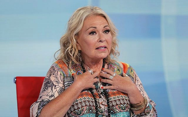 Roseanne Barr talks with Fox News talk show host Sean Hannity while being interviewed during a taping of his show, July 26, 2018, in New York. (AP Photo/Julie Jacobson)