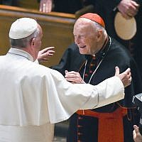 In this Sept. 23, 2015 file photo, Pope Francis reaches out to hug Cardinal Archbishop emeritus Theodore McCarrick after the Midday Prayer of the Divine with more than 300 U.S. Bishops at the Cathedral of St. Matthew the Apostle in Washington. (Jonathan Newton/The Washington Post via AP, Pool, File)