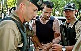 Lebanese citizen Assad Ahmad Barakat, (c), arrives at a courthouse in Asuncion, Paraguay, November 17, 2003. (AP Photo/Jorge Saenz)