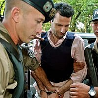 Lebanese citizen Assad Ahmad Barakat, (c), arrives at a courthouse in Asuncion, Paraguay, November 17, 2003. (AP Photo/Jorge Saenz)