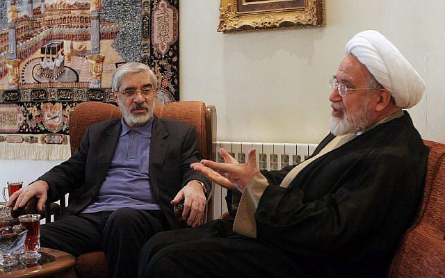 Iranian opposition leaders, Mahdi Karroubi, right, and Mir Hossein Mousavi talk in Tehran, Iran, Oct. 10, 2009. (AP)