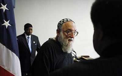 Rabbi Arthur Waskow of the Shalom Center in Philadelphia leaves the podium as Mahdi Bray, Executive Director of Muslim American Society (MAS) Freedom, is seen at rear at a news conference at the National Press Club in Washington, Aug. 17, 2010 (AP Photo/Charles Dharapak)