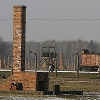 People walk through the Nazi death camp Auschwitz-Birkenau in Oswiecim, Poland, on January 28. 2011. (AP Photo/Czarek Sokolowski/ File)
