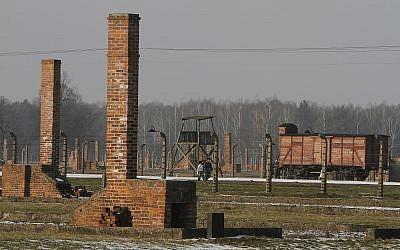 People walk through the Nazi death camp Auschwitz-Birkenau in Oswiecim, Poland, on January 28. 2011. (AP Photo/Czarek Sokolowski/ File)