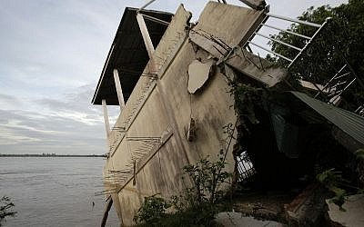 Illustrative image of s local house damaged by floods in Laos in 2011. (AP Photo/Heng Sinith)