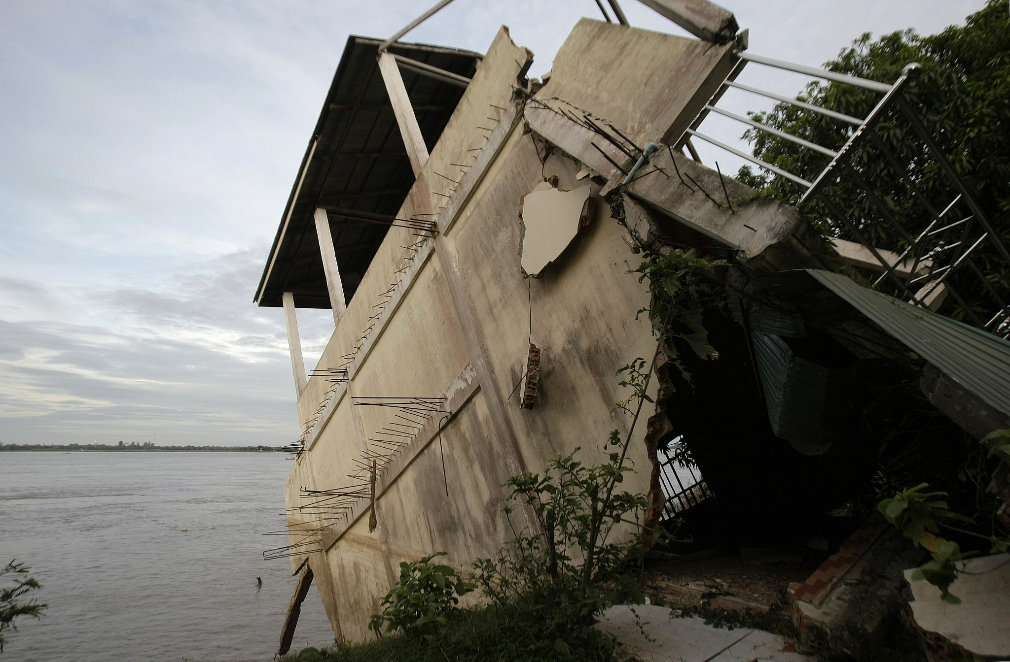 Illustrative image of s local house damaged by floods in Laos in 2011. (AP