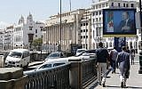 Illustrative: Algerians walk past a portrait of Algerian President Abdelaziz Bouteflika in the capital Algiers on May 2, 2017. (AP Photo/ Toufik Doudou)