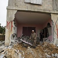 File: A Palestinian inspects the family house of Omar Al-Abed after it was demolished by Israeli authorities in the West Bank village of Kobar, near Ramallah, Aug. 16, 2017. Al-Abed stabbed to death three Jewish residents of a nearby settlement in July 2017. (AP Photo/Nasser Shiyoukhi)