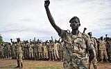 FILE - In this Thursday, May 18, 2017, file photo, soldiers cheer at a ceremony marking the 34th anniversary of the Sudan People's Liberation Army (SPLA), attended by President Salva Kiir, in the capital Juba, South Sudan. (AP /Samir Bol)