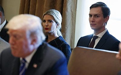 Ivanka Trump, center, and White House senior adviser Jared Kushner, right, listen to US President Donald Trump during a cabinet meeting at the White House, in Washington, November 20, 2017. (Evan Vucci/AP)