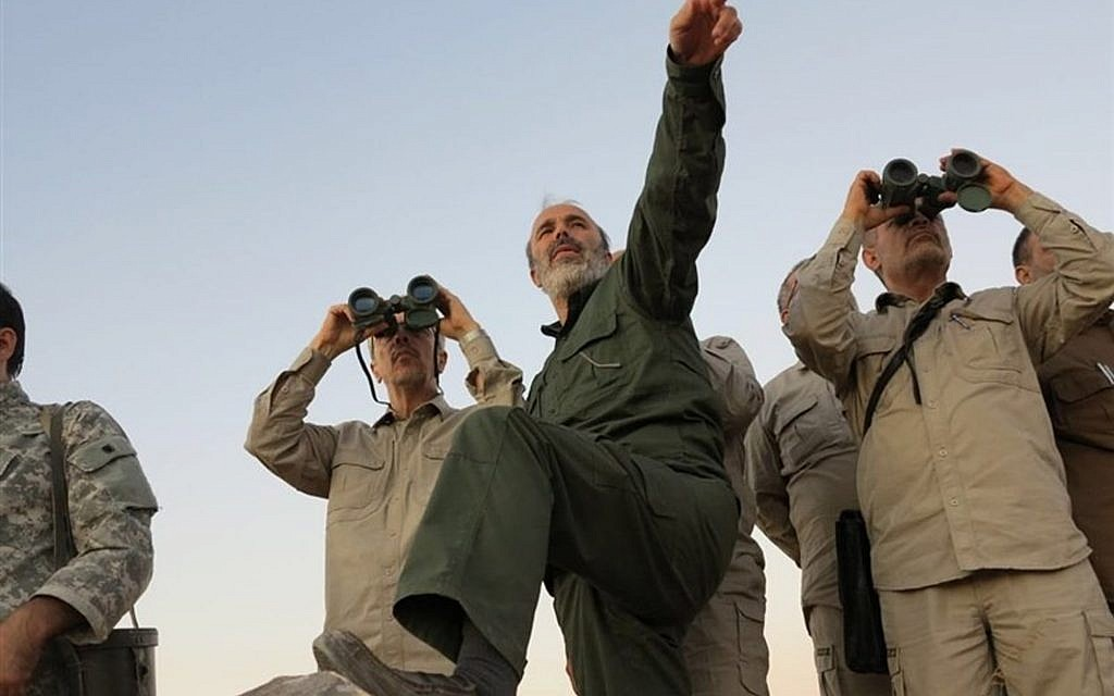 The government-controlled Syrian Central Military Media shows Iran's army chief of staff Maj. Gen. Mohammad Bagheri, left, looks into binoculars as he visits and other senior officers from the Iranian military on a front line in the northern province of Aleppo, Syria, October 20, 2017. (Syrian Central Military Media, via AP)