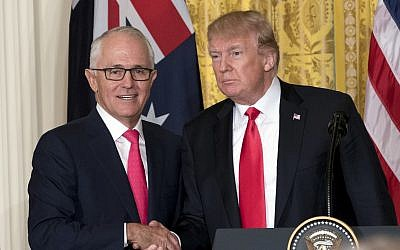 US President Donald Trump (r) and Australian Prime Minister Malcolm Turnbull shake hands following a joint news conference in the East Room of the White House in Washington, February 23, 2018. (AP Photo/Andrew Harnik)