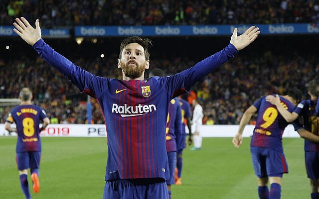 Barcelona's Lionel Messi greets fans after scoring his side's second goal during a Spanish La Liga soccer match between Barcelona and Real Madrid, dubbed 'El Clasico', at the Camp Nou stadium in Barcelona, Spain, May 6, 2018. (AP Photo/Emilio Morenatti)
